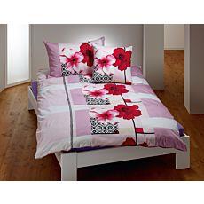 Bettwäsche gemustert mit roten und weissen Hibiskusblüten
